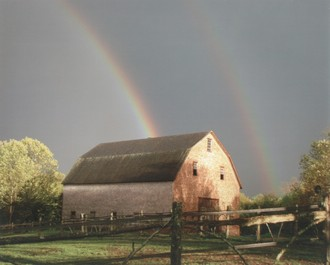Rainbow over a barn